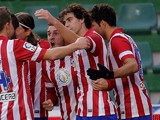 Atletico Madrid's midfielder Koke celebrates with his teammates after scoring during the Spanish league football match Elche vs Club Atletico de Madrid at the Manuel Martinez Valero Stadium in Elche on November 30, 2013
