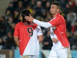 Monaco's French forward Emmanuel Riviere cheers Monaco's Colombian forward Radamel Falcao during the French L1 football match Nantes against Monaco on November 24, 2013