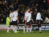 Liverpool players walk off after their 3-1 defeat during the Barclays Premier League match between Hull City and Liverpool at KC Stadium on December 1, 2013