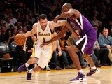 Jordan Farmar #1 of the Los Angeles Lakers drives against Travis Outlaw #25 of the Sacramento Kings at Staples Center on November 24, 2013