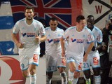 Marseille's French midfielder Florian Thauvin celebrates with teammates after scoring on November 29, 2013