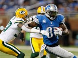 Calvin Johnson #81 of the Detroit Lions tries to get around the tackle of Sam Shields #37 of the Green Bay Packers during the first quarter at Ford Field on November 28, 2013