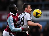 Scott Parker vies with Mohamed Diame during the English Premier League football match between West Ham United and Fulham on November 30, 2013