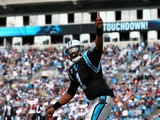 Cam Newton #1 of the Carolina Panthers celebrates after running for a touchdown against the Tampa Bay Buccaneers during their game at Bank of America Stadium on December 1, 2013