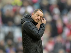 Braunschweig's headcoach Torsten Lieberknecht wipes his eye ahead of the German first division Bundesliga football match Bayern Muenchen vs Eintracht Braunschweig in Munich, southern Germany on November 30, 2013
