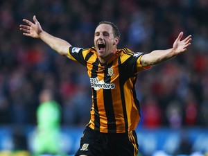 David Meyler of Hull City celebrates scoring his team's second goal during the Barclays Premier League match between Hull City and Liverpool at KC Stadium on December 1, 2013