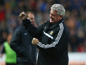 Steve Bruce, manager of Hull City celebrates his team's third goal during the Barclays Premier League match between Hull City and Liverpool at KC Stadium on December 1, 2013