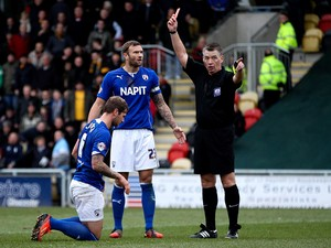 Liam Cooper of Chesterfield is sent off by referee Mark Haywood during the Sky Bet League Two match between Newport County AFC and Chesterfield at Rodney Parade on December 01, 2013