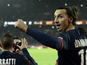 Paris Saint-Germain's Swedish forward Zlatan Ibrahimovic celebrates with teammates after scoring a goal during the French L1 football match between Paris Saint-Germain (PSG) and Lyon (OL) on December 1, 2013