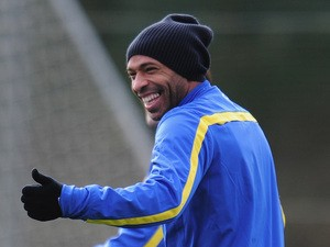 Former Arsenal player Thierry Henry warms up during a training session at London Colney on November 25, 2013