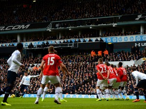 Kyle Walker of Tottenham Hotspur scores the opening goal from a free kick during the Barclays Premier League Match between Tottenham Hotspur and Manchester United at White Hart Lane on December 1, 2013