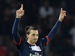Paris Saint-Germain's Zlatan Ibrahimovic celebrates after scoring the opening goal against Olympiakos during their Champions League group match on November 27, 2013