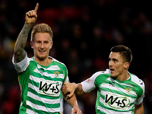 Byron Webster of Yeovil celebrates after opening the scoring during the Sky Bet Championship match between Watford and Yeovil Town at Vicarage Road on November 30, 2013