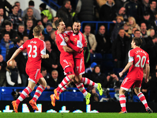 Southampton's English striker Jay Rodriguez celebrates scoring the opening goal with teammate Italian striker Dani Osvaldo during the English Premier League football match between Chelsea and Southampton at Stamford Bridge in London on December 1, 2013