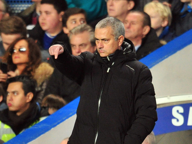 Chelsea's Portuguese manager Jose Mourinho gestures during the English Premier League football match between Chelsea and Southampton at Stamford Bridge in London on December 1, 2013