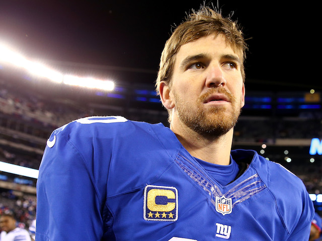 Eli Manning of the New York Giants walks off the field after the loss to the Dallas Cowboys at MetLife Stadium on November 24, 2013