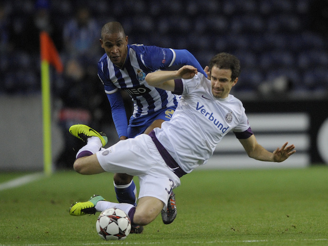 Austria Wien's defender Fabian Koch vies with Porto's Brazilian midfielder Fernando Reges during the UEFA Champions League group G football match on November 26, 2013