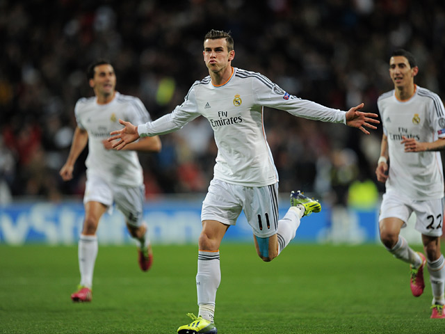Real Madrid's Gareth Bale celebrates after scoring the opening goal against Galatasaray during their Champions League group match on November 27, 2013