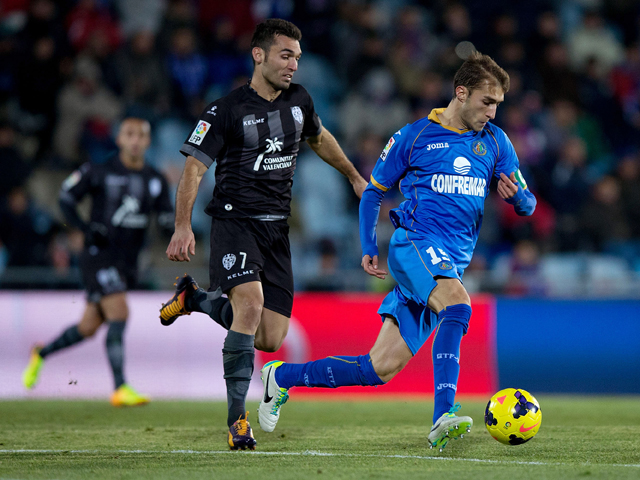 Rafael Lopez of Getafe CF competes for the ball with David Barral Torres of Levante UD during the La Liga match between Getafe CF and Levante UD at Coliseum Alfonso Perez on November 29, 2013