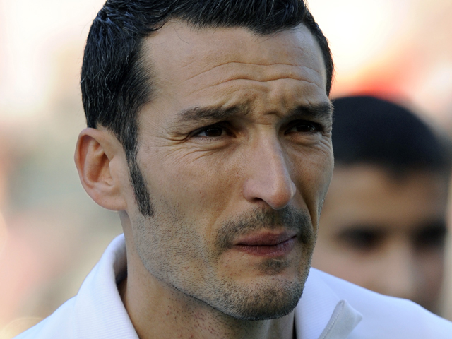 Italy's defender Gianluca Zambrotta listens to the national anthems ahead of the friendly football match match Italy vs Mexico at the Heizel stadium in Brussels on June 3, 2010