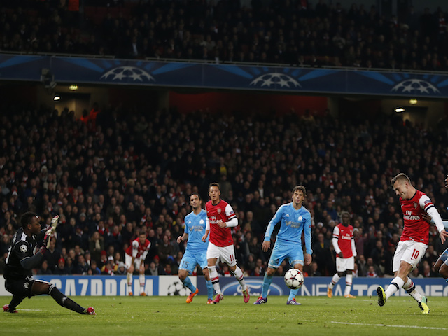 Arsenal's English midfielder Jack Wilshere scores his second goal during the UEFA Champions League group F football match between Arsenal and Olympique de Marseille at the Emirates Stadium on November 26, 2013