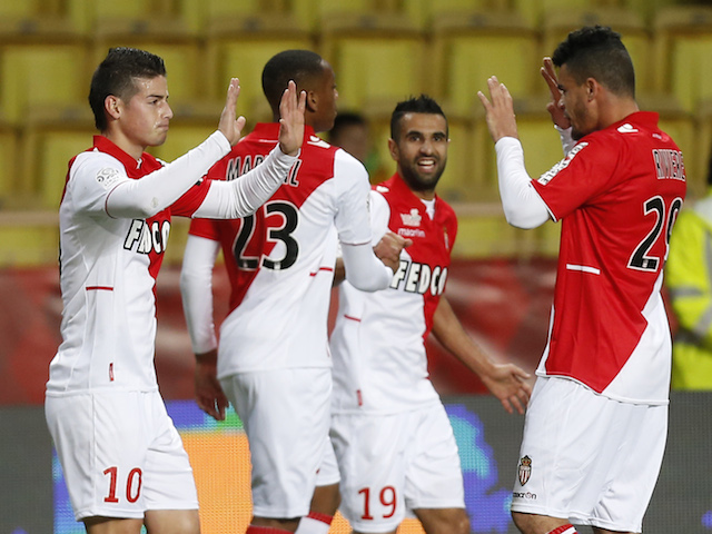 Monaco's James Rodriguez celebrates with Emmanuel Riviere and team mates after scoring a goal during a French L1 football match against Rennes on November 30, 2013