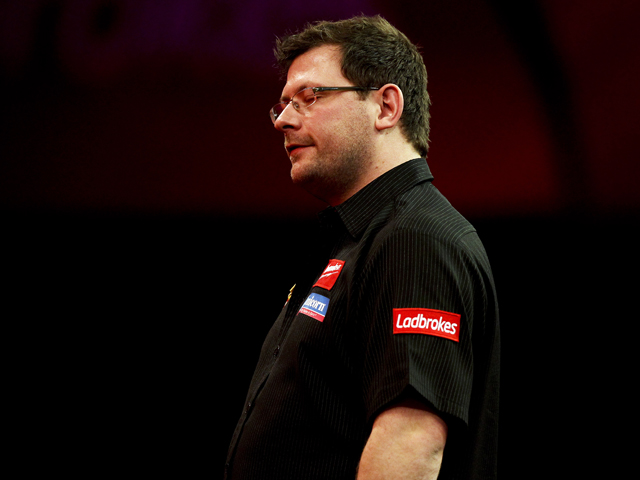James Wade of England looks dejected during his semi final match against Michael van Gerwen of the Netherlands on day fourteen of the 2013 Ladbrokes.com World Darts Championship at the Alexandra Palace on December 30, 2012