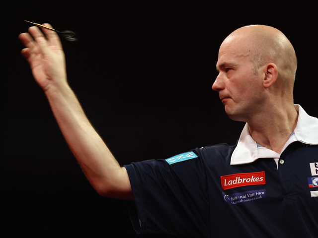 Jamie Caven of Great Britain in action in his first round match against Roland Scholten of the Netherlands during day one of the 2012 Ladbrokes.com World Darts Championship at Alexandra Palace on December 15, 2011