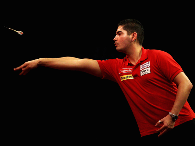 Jelle Klaasen of Holland collects his darts in his match against James Wade of England during day nine of the 2012 Ladbrokes.com World Darts Championship at Alexandra Palace on December 23, 2011