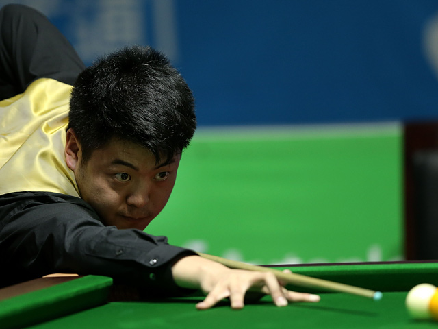 Liang Wenbo in action during the Billiards Men's Team Gold Medal Match between China and Independent Olympic Athletes on July 2, 2013