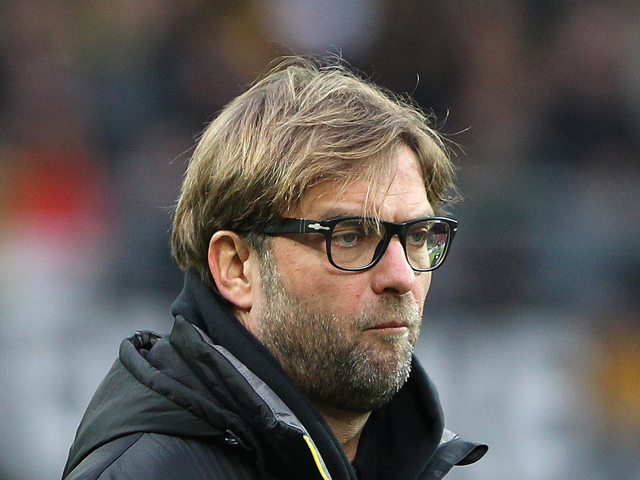 Dortmund's head coach Jürgen Klopp looks on ahead of the German first division Bundesliga football match FSV Mainz 05 vs Borussia Dortmund in Mainz, Central Germany on November 30, 2013