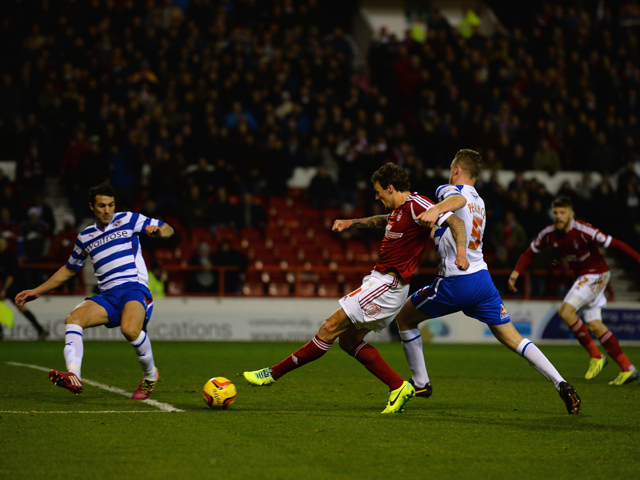Darius Henderson of Nottingham Forest scores the equalising goal during the Sky Bet Championship match between Nottingham Forest and Reading at City Ground on November 29, 2013