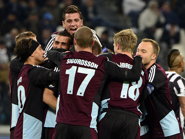 Copenhagen's Olof Mellberg is congratulated by teammates after scoring his team's opening goal against Juventus during their Champions League group match on November 27, 2013