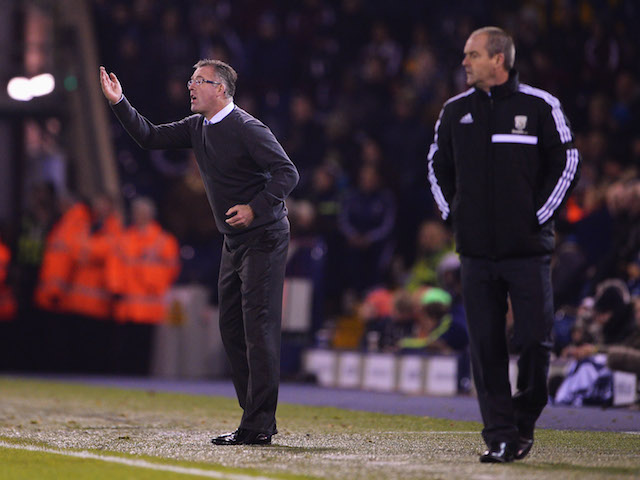Paul Lambert manager of Aston Villa and Steve Clarke manager of West Bromwich Albion look on from the touchline during the Barclays Premier League match on November 25, 2013