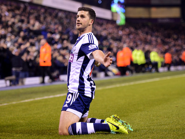 Shane Long of West Bromwich Albion celebrates as he scores their second goal during the Barclays Premier League match against Aston Villa on November 25, 2013