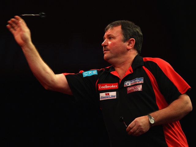 Terry Jenkins of England throws in his match against Co Stompe of Holland during Day 10 of the 2012 Ladbrokes.com World Darts Championship at Alexandra Palace on December 27, 2011