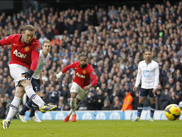 Manchester United's English striker Wayne Rooney scores his second goal from the penalty spot during the English Premier League football match between Tottenham Hotspur and Manchester United at White Hart Lane in London, on December 1, 2013