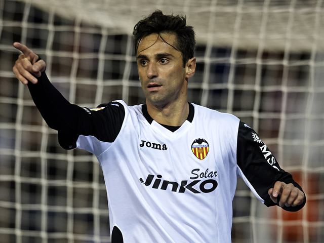 Jonas of Valencia celebrates after scoring during the La Liga match between Valencia CF and CA Osasuna at Estadio Mestalla on December 01, 2013