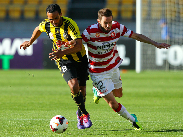 Paul Ifill of the Phoenix and Dean Heffernan of the Wanderers compete for the ball during the round eight A-League match between the Wellington Phoenix and the Western Sydney Wanderers at Westpac Stadium on December 1, 2013