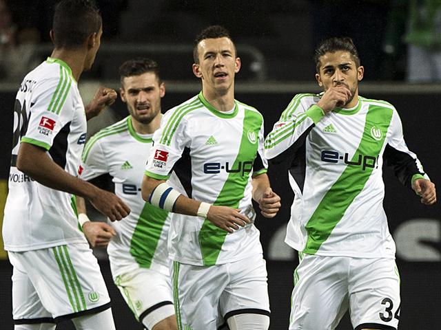 Wolfsburg's Swiss defender Ricardo Rodriguez celebrates after scoring during the German first division Bundesliga football match VfL Wolfsburg vs Hamburger SV in Wolfsburg on November 29, 2013
