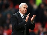 Newcastle manager Alan Pardew celebrates victory at the end of the match against Man United on December 7, 2013