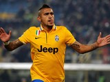 Juventus' Arturo Vidal celebrates after scoring the opening goal against Bologna during their Serie A match on December 6, 2013