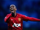 Ashley Young celebrates Manchester United's win over Manchester City on December 09, 2012.