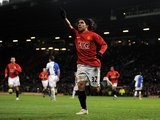 Carlos Tevez celebrates one of his four goals for Manchester United against Blackburn Rovers on December 03, 2008.