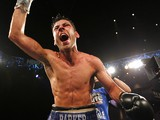 Darren Barker of England celebrates his split decision victory over Daniel Geale from Australia during their IBF Middleweight Championship fight on August 17, 2013