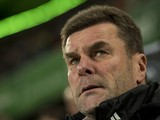 Wolfsburg's head coach Dieter Hecking stands by the pitch prior to the German first division Bundesliga football match Wolfsburg vs Hamburg in Wolfsburg on November 29, 2013