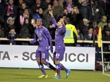Fiorentina's Giuseppe Rossi celebrates after scoring his team's third goal against Hellas Verona during their Serie A match on December 2, 2013
