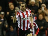 Sunderland's John O'Shea celebrates after scoring his team's second goal against Chelsea during their Premier League match on December 4, 2013