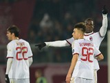 AC Milan Mario Balotelli (R) celebrates with teammate forwad Stephan el Shaarawy after scoring a free kick during the Serie A football match Livorno vs AC Milan at the Armando Picchi stadium in Livorno on December 7, 2013