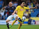 Nicky Bailey of Millwall battles with Adam Clayton of Huddersfield during the Sky Bet Championship match between Millwall and Huddersfield Town at The Den on August 17, 2013